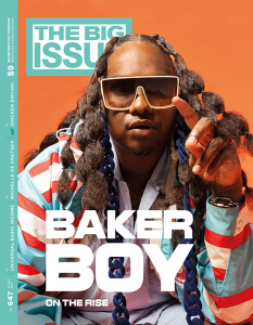 Baker Boy on the cover of our latest edition, wearing classes and a felt covered blue chain.